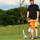 Father and Son playing FootGolf